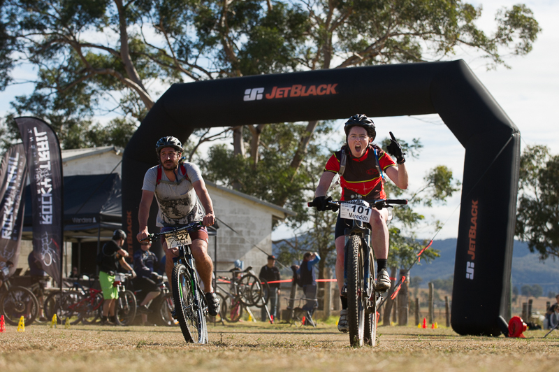 Meredith Quinlan enjoying the event centre atmosphere as she comes through on her way to the Elite Master and overall women's win.