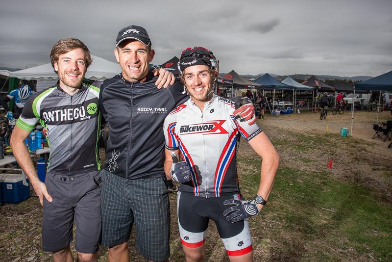 Organiser Martin Wisata revving up the series leaders ahead of the race - Callum McNamara (l) and Max Richardson (r).
