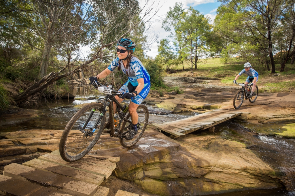 Charlie McCabe crossing the creek at Mowbray Park Farm, team manager Jason Moxham right behind her.